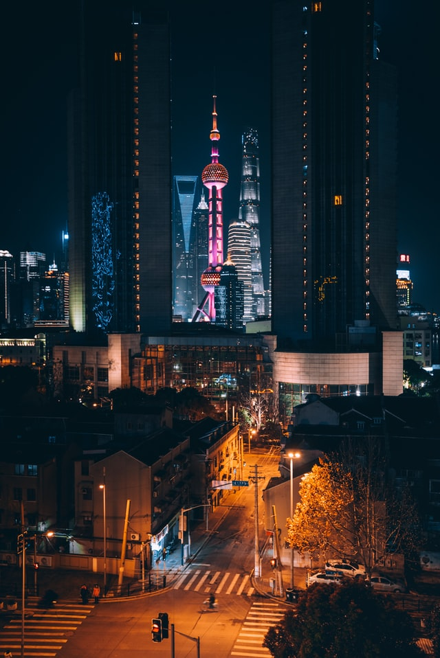 Investing in the Oriental pearl: Shanghai city photographed at night, Yir An Ding   Unsplash