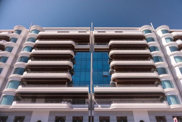 Symmetrical building in Le Quai Kennedy, Monaco — Kit Suman   Unsplash
