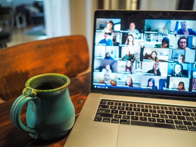 macbook pro displaying group of people photo chris montgomery unsplash