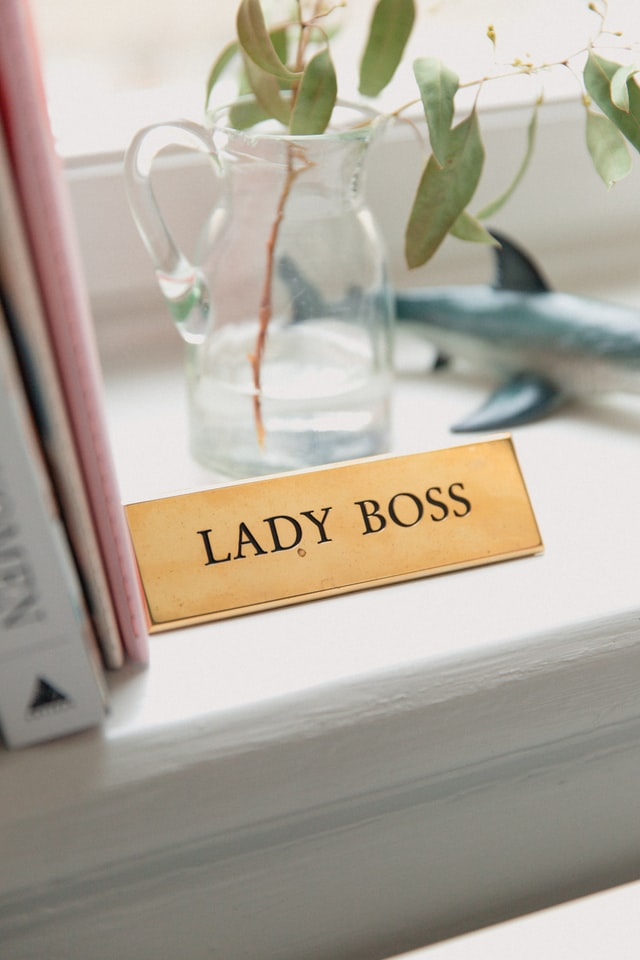 """Photograph of a desk with name plate saying """"LADY BOSS"""""""