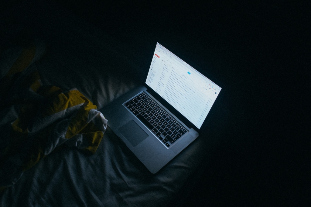 apple macbook pro on bed photo