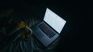 apple macbook pro on bed photo