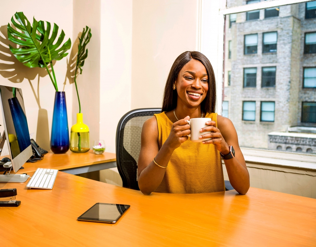 Women holding white ceramic mug office design