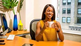 Women holding white ceramic mug office design
